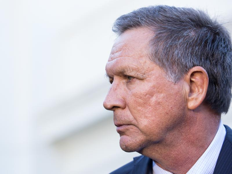 Ohio Gov. John Kasich signed a 20-week abortion ban into law Tuesday, the same day he vetoed legislation outlawing abortions once a fetus's heartbeat is detectable. Above, Kasich in Washington, D.C., last month.