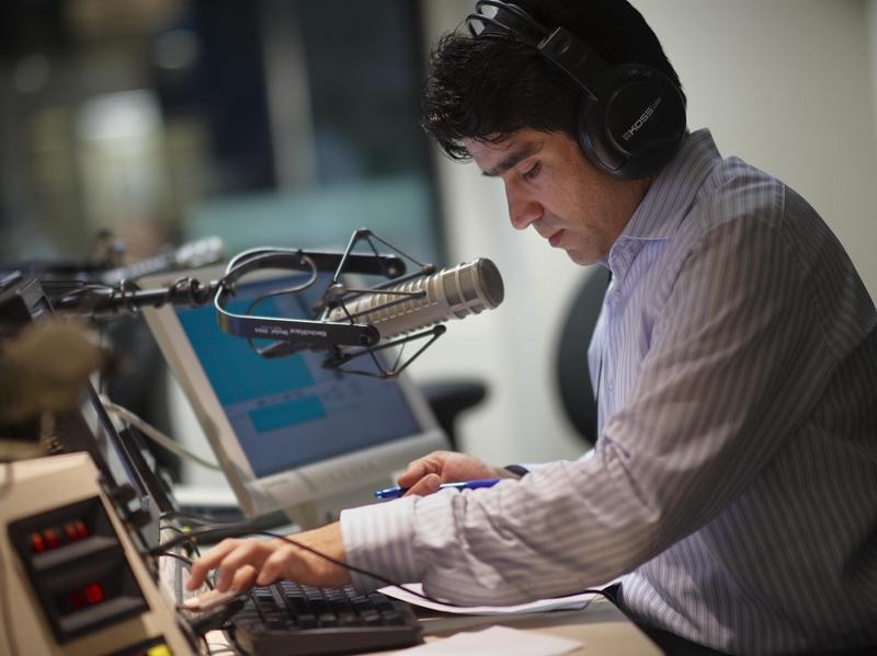 Voice Of America Afghan Service broadcaster Daoud Sediqi listens to a caller in 2009 in a studio in Washington. The federally funded outlet and its affiliates broadcast news around the world in multiple languages.