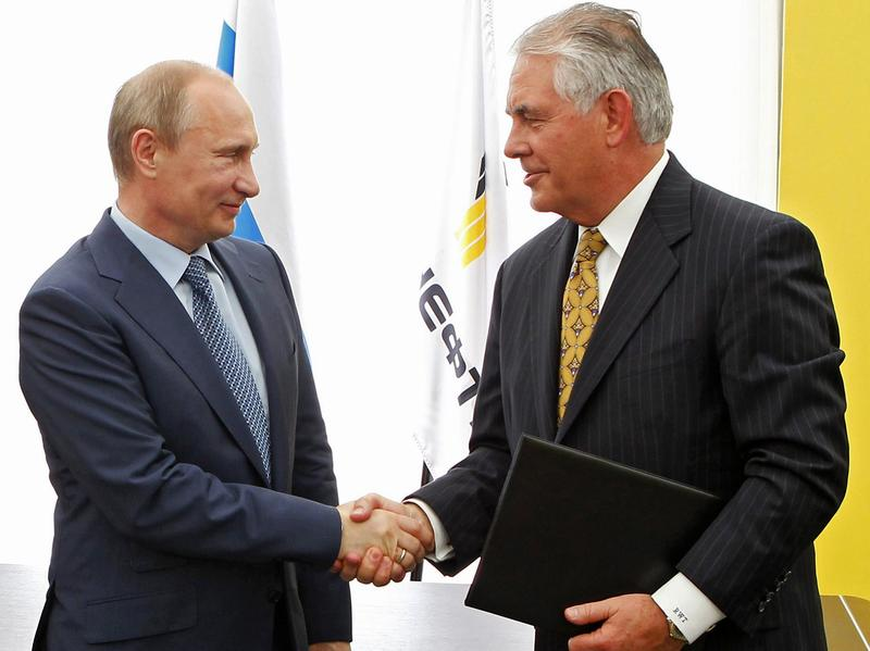Russian President Vladimir Putin (left), and Exxon Mobil CEO Rex Tillerson, now the secretary of state-designate, shake hands at a 2012 signing ceremony in Tuapse, southern Russia. Tillerson has expressed a general opposition to the sanctions that the Obama administration imposed on Russia two years ago.