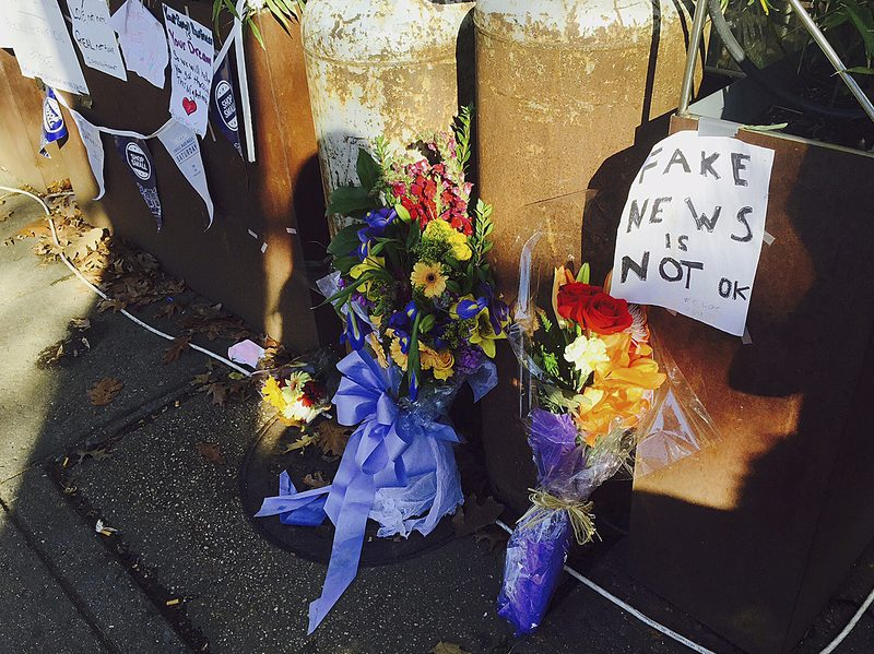 Flowers and notes left outside Comet Ping Pong pizzeria in Washington, D.C., on Dec. 9.