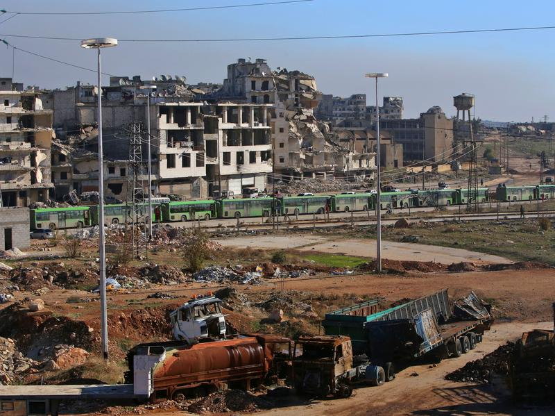Buses line up outside the rebel-held enclave of eastern Aleppo on Thursday, preparing to evacuate rebels and civilians.