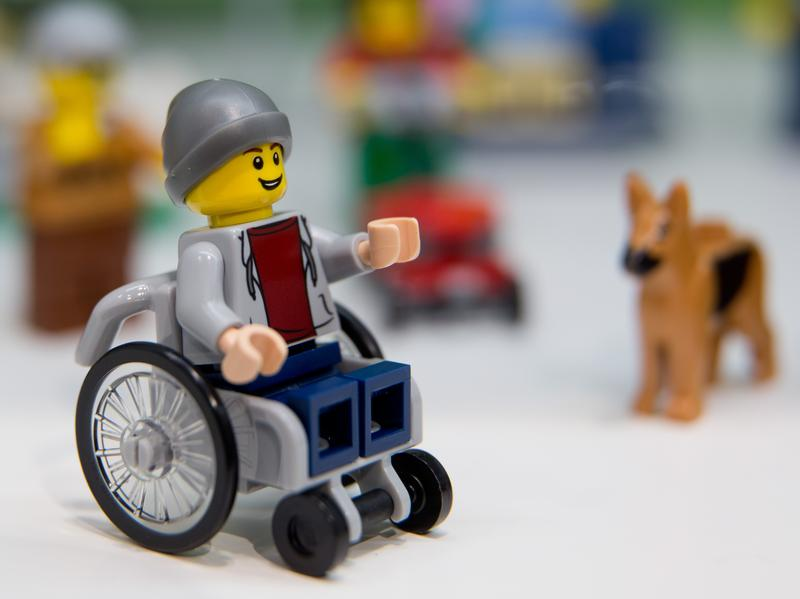 """A Lego figure in a wheelchair was introduced at the 67th International Toy Fair in January 2016. He comes in the """"City"""" set, a community of figures shown playing and working in an urban park setting."""