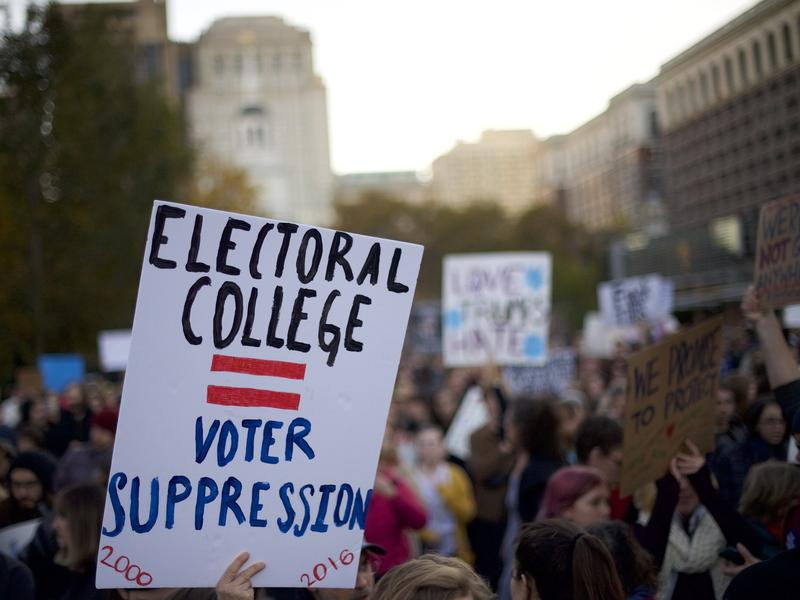 Protesters demonstrate in Philadelphia last week. Republican Donald Trump is assured of a victory, unless there is a massive — and totally unexpected — defection by the electors pledged to support him.
