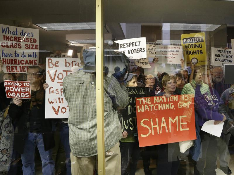 Protesters gather Thursday during a special session at the North Carolina Legislature in Raleigh.