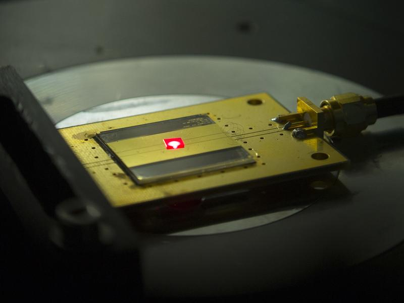 A tiny radio receiver built from components the size of two atoms. It emits a signal as red light, which is then converted into an electrical current and can be broadcast as sound by a speaker or headphone.