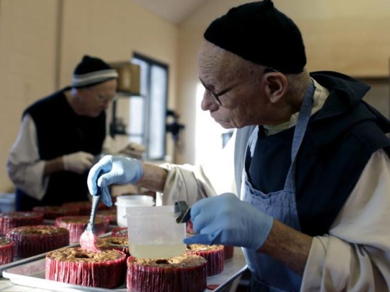 A monk prepares fruitcakes at Assumption Abbey in Ava, Mo. The bakery makes about 6,000 pounds of fruitcake per year.