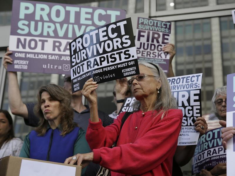 Activists from UltraViolet, a national women's advocacy organization, push for the removal of Judge Aaron Persky from the bench in San Francisco in June. The judge has since been cleared of misconduct.