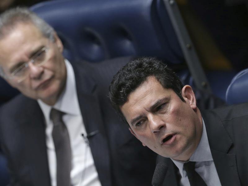 Brazilian Federal Judge Sergio Moro (right) is leading his country's corruption probe of state-run oil company Petrobras. Two Brazilian companies have agreed to more than $3.5 billion in fines for violating U.S. bribery laws in their dealings with Petrobras.