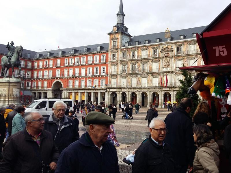Tourists browse a Christmas market in Madrid's medieval square, the Plaza Mayor, on Dec. 15. As the Islamic State loses territory in Iraq and Syria, Western intelligence agencies believe it may refocus on attacking soft targets in Europe instead.
