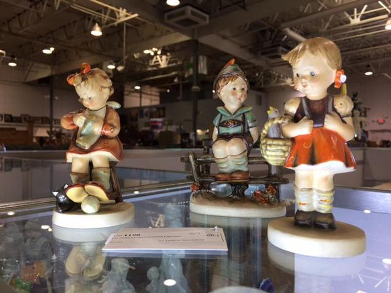These porcelain figurines, commonly called Hummels, were popular collectibles in the 1970s. (Christina Estes/KJZZ)