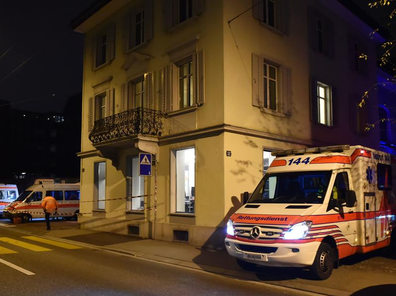 Ambulance and police cars outside an Islamic center in central Zurich on Monday after three people were injured by gunfire. Police say the gunman later killed himself.