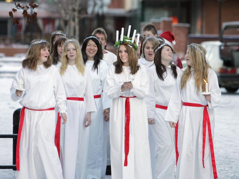 On Santa Lucia Day in Sweden, it's tradition to dress as the Sicilian saint and serve coffee and <em>lussebullar </em>(saffron buns) in her honor.