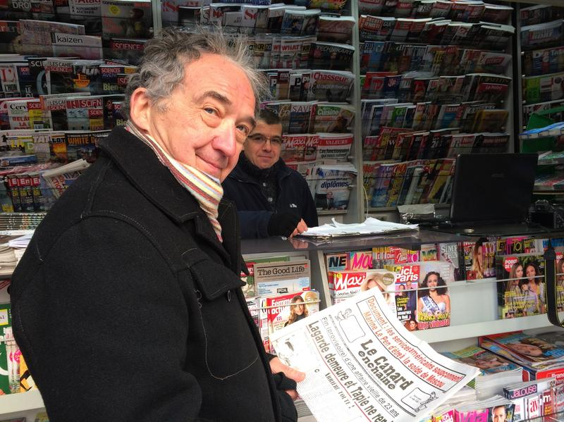 Frenchman Jean Yves Boyer buys a copy of the French weekly <em>Le Canard Enchainé,</em> which marks its 100th anniversary this year. It sells 400,000 copies a week and is profitable, though it has no advertising and just a bare-bones webpage.