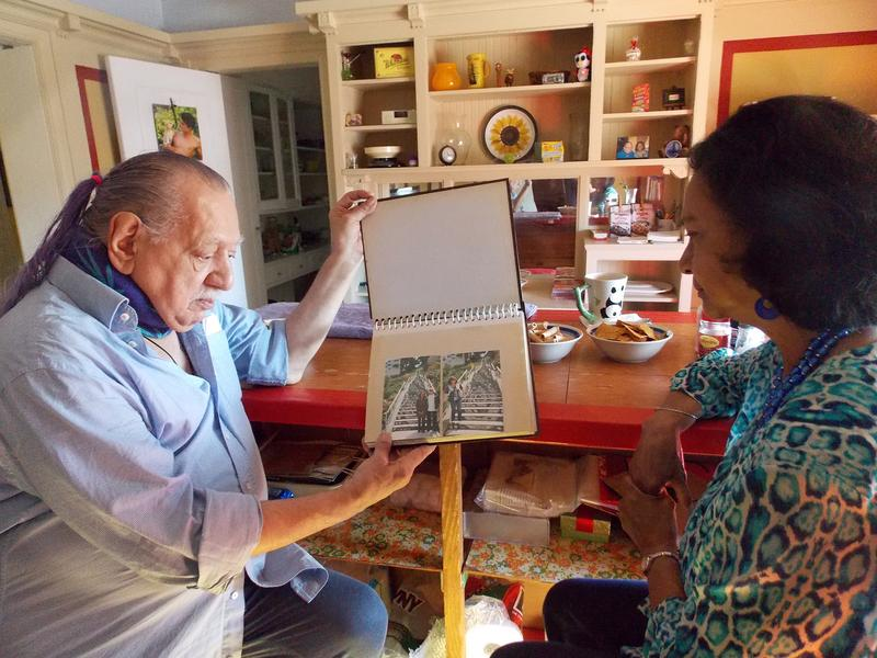 Emil Girardi, 83, and Shipra Narruhn, 67, chat in Girardi's San Francisco apartment. They were paired through a nonprofit called Little Brothers, Friends of the Elderly, which aims to relieve isolation and loneliness.
