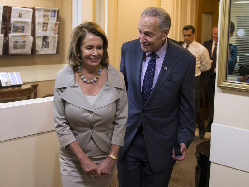 Nancy Pelosi and Chuck Schumer at a 2015 press conference. The two Democratic leaders are plotting out how to work with a Republican president and Congress next year.