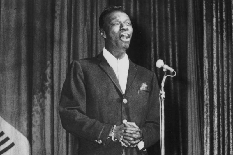 Nat King Cole performing in 1960. (Fox Photos/Getty Images)
