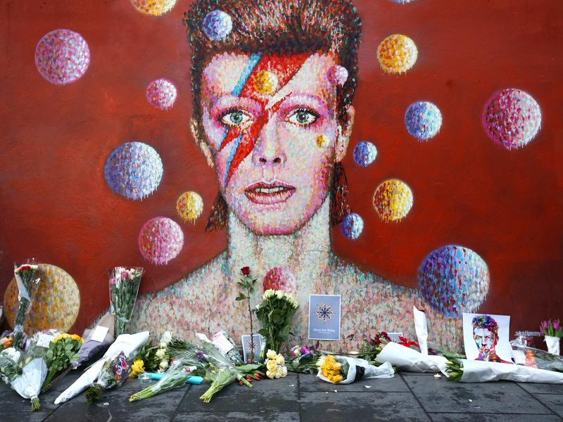 Flowers are laid beneath a mural of David Bowie in London in January.