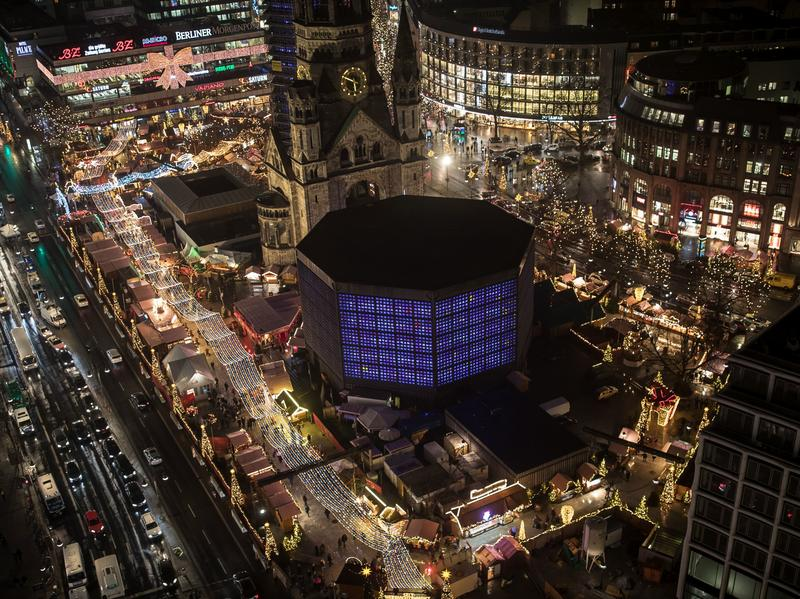 The Christmas market near the Kaiser Wilhelm Memorial Church in Berlin continues on Dec. 22. Somber but determined not to be cowed, visitors flocked to the market as it reopened three days after being struck in a deadly truck assault.