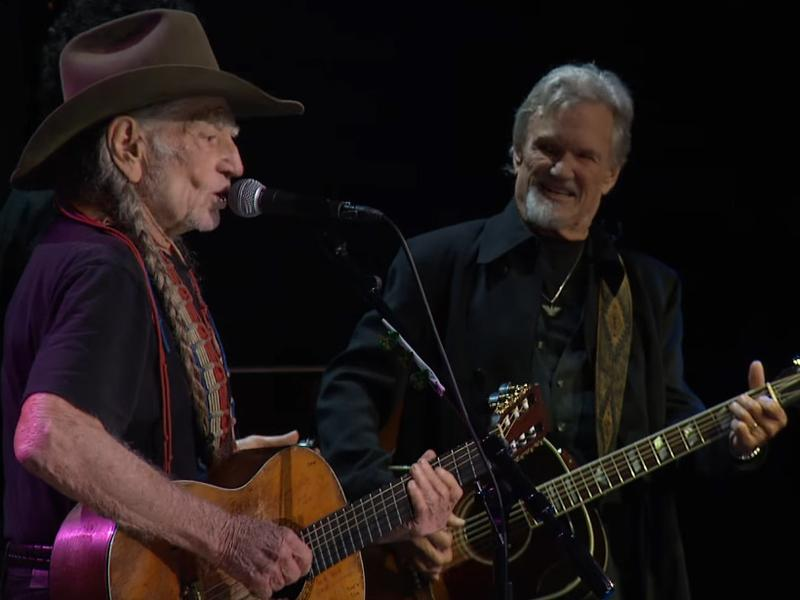 Willie Nelson performs with Kris Kristofferson.