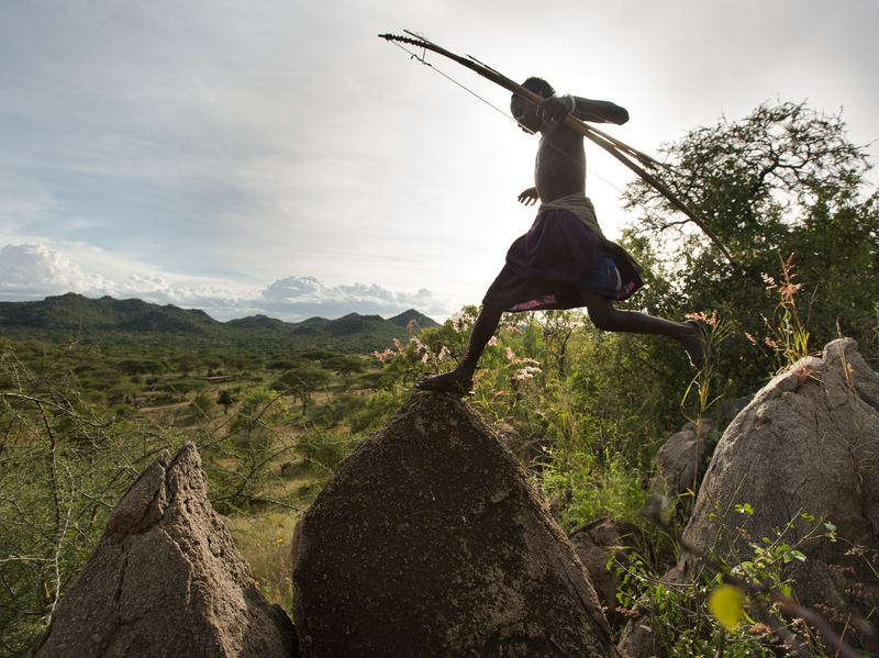 A Hadza man on a hunt, with his bow and arrow.