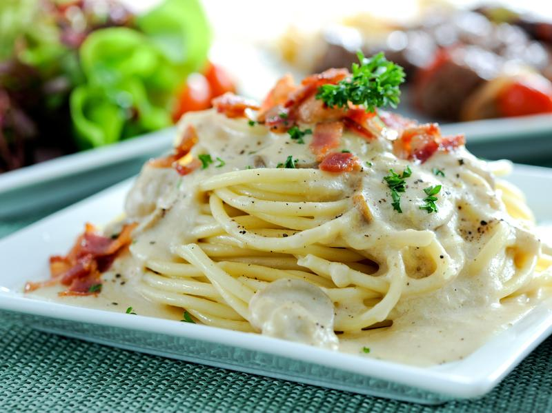 Pasta Carbonara is made with spaghetti, eggs, cheese and pork.