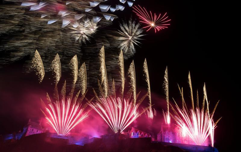 Fireworks light up the sky above Edinburgh Castle as part of Hogmanay celebrations on Dec. 31, 2015 in Edinburgh, Scotland. (Ross Gilmore/Getty Images for Unicef)