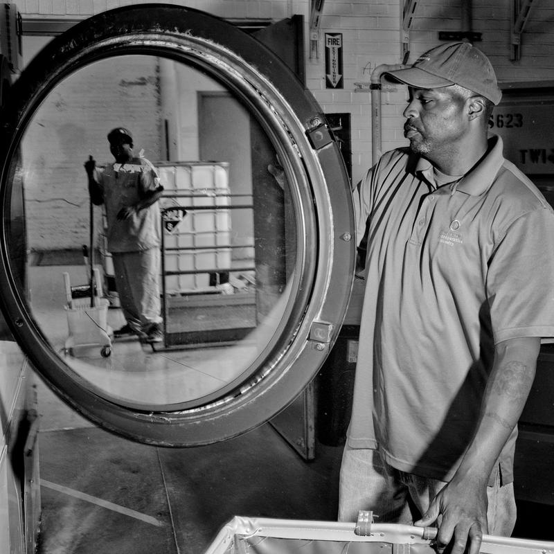 Chris Brown, working at the Evergreen Cooperative Laundry in Cleveland. He started out sweeping floors. Now he's a supervisor. The worker-owned company is a bright spot in one of the neediest American cities, where nearly 40 percent of residents live in poverty. (Courtesy Matt Black/Magnum Photos via Smithsonian)