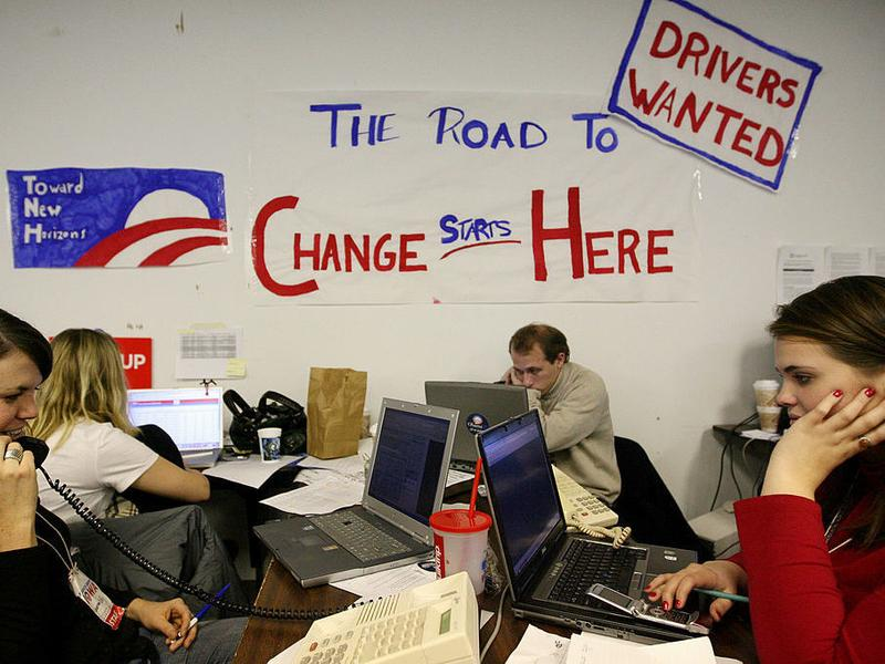 """Volunteers in Des Moines make calls at the campaign headquarters of then-Democratic presidential hopeful Sen. Barack Obama on Dec. 5, 2007 ahead of the Iowa caucus. Obama has called those """"fired-up"""" campaign workers from his 2008 campaign, one of his proudest legacies."""