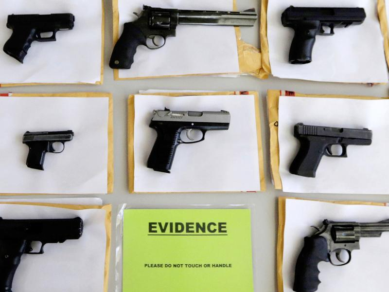 Some of the thousands of illegal firearms Chicago police confiscated in 2014.