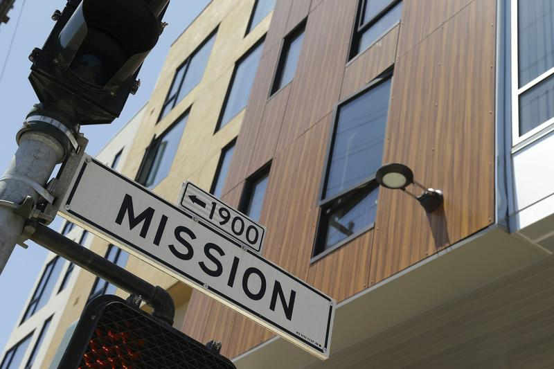 A street sign hangs outside a then-new apartment building on Mission Street, Tuesday, June 2, 2015, in San Francisco. (Eric Risberg/AP)