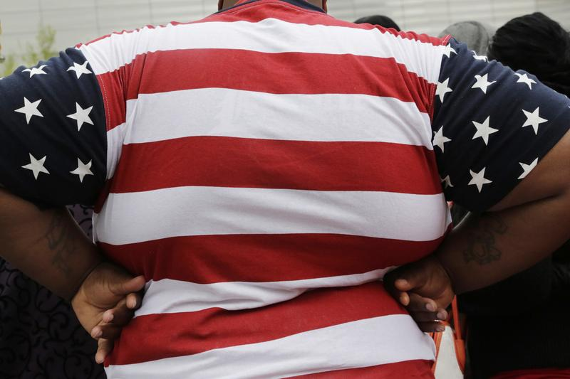 In this May 8, 2014 file photo, an overweight man is seen in New York. (Mark Lennihan/AP)