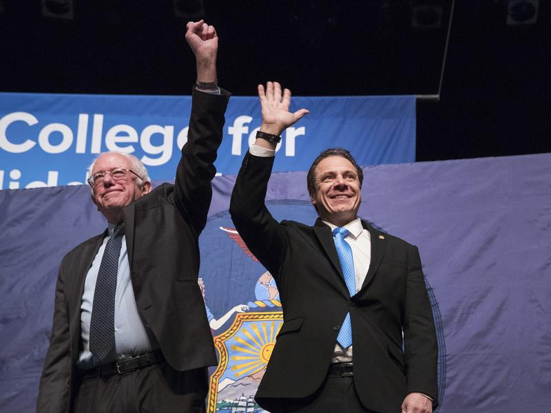 New York Gov. Andrew Cuomo (right) announced a proposal Tuesday to offer tuition-free college to lower-income New Yorkers. His plan mirrors those of last year's Democratic presidential hopefuls, including Vermont Sen. Bernie Sanders (left).