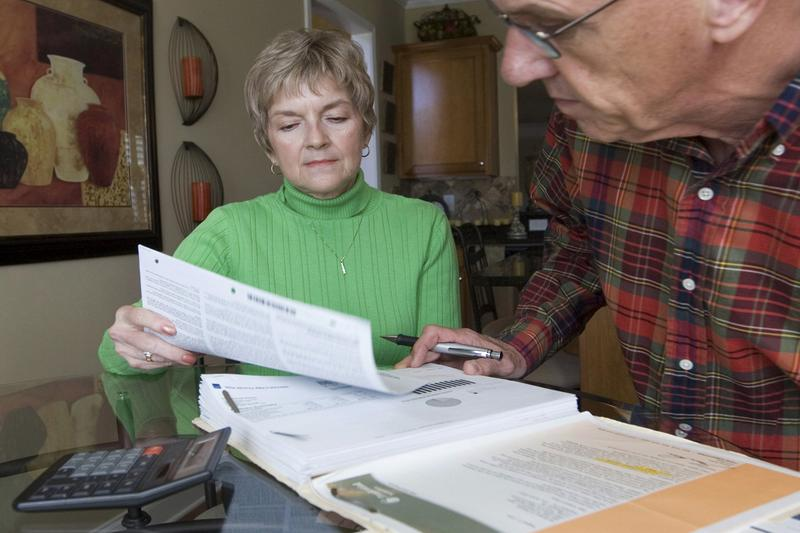 In this file photo ,Judy and Bob Dienell review their financial statements Saturday, Oct. 25, 2008, in Braselton, Ga. (John Amis/AP)