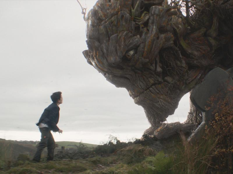 Agony Ent: A grieving Conor (Lewis MacDougall) confronts his local monster (voiced by Liam Neeson).