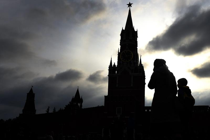 People walk across Red Square, with the Kremlin's Spasskaya Tower seen in the background, in central Moscow in October 2016. (Vasily Maximov/AFP/Getty Images)