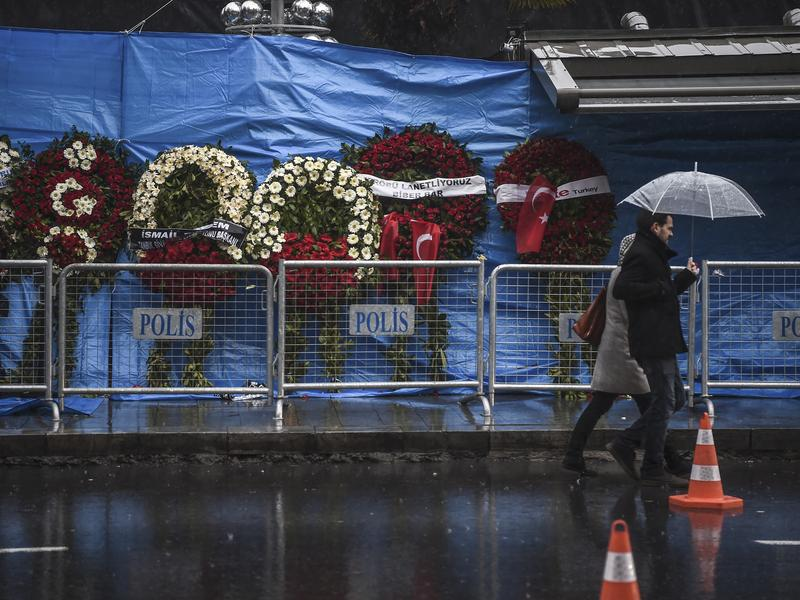 A couple walk past the Reina nightclub in Istanbul, days after a gunman killed 39 people on New Year's night.