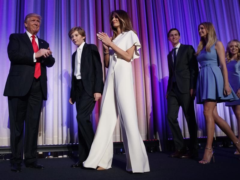 Melania Trump wore a white, one-shouldered Ralph Lauren jumpsuit to her husband's election night rally.