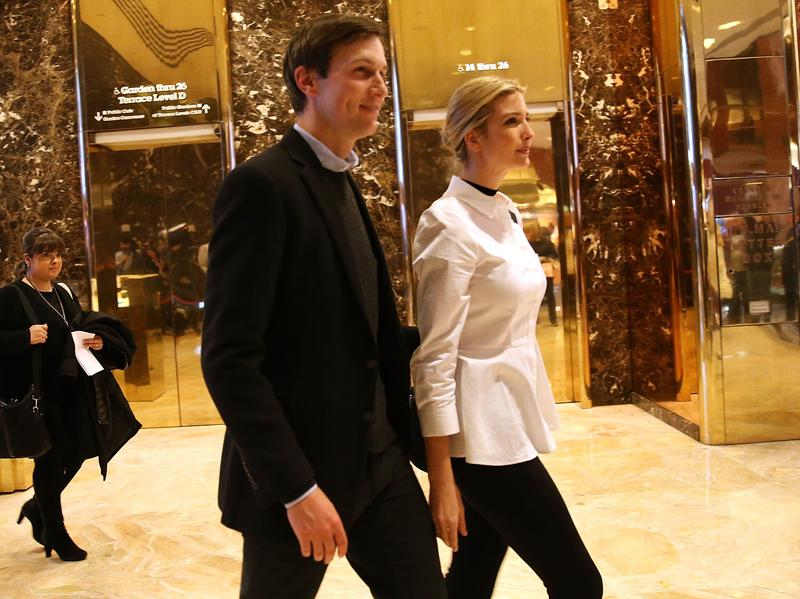 Jared Kushner, the son-in-law of President-elect Donald Trump, and wife Ivanka walk though the lobby of Trump Tower in New York on Nov.18, 2016.