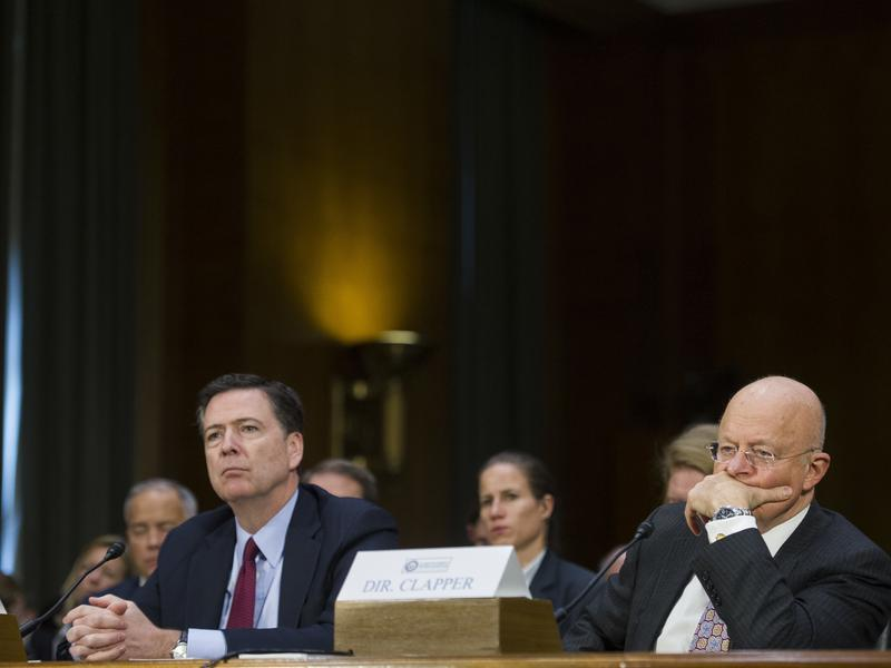 FBI Director James Comey (left) and National Intelligence Director James Clapper testify during a Senate Intelligence Committee hearing Tuesday.