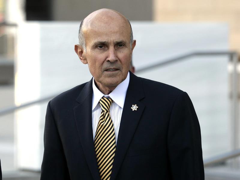 Former Los Angeles County Sheriff Lee Baca leaves federal court in Los Angeles, near the end of his December 2016 trial of charges of obstruction and conspiracy. A mis-trial was declared. Baca will be retried.