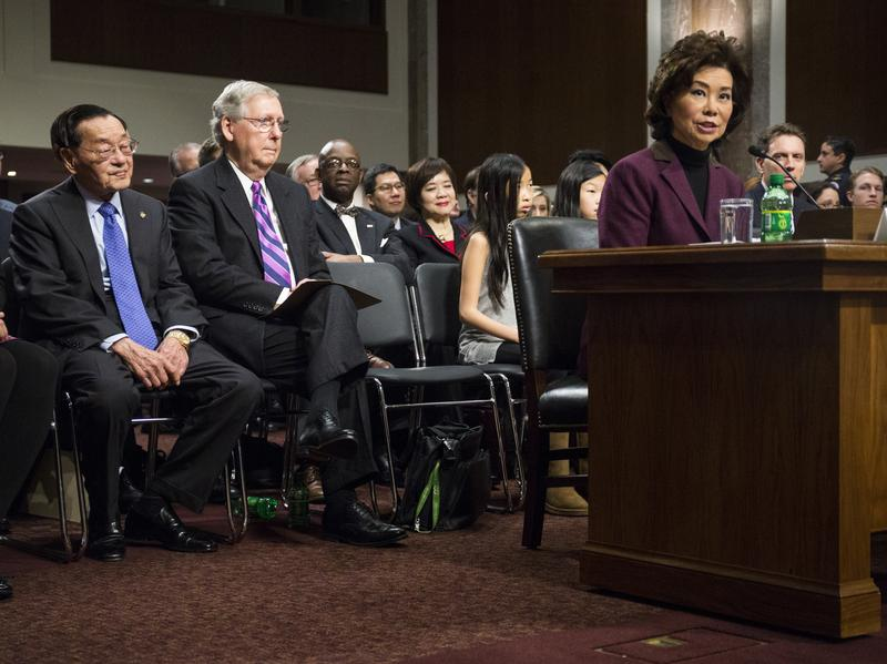 Secretary of Transportation-designate Elaine Chao testifies at her confirmation hearing before the Senate Commerce, Science and Transportation Committee. Listening are her father, James Chao, left, and husband, Senate Majority Leader Mitch McConnell.