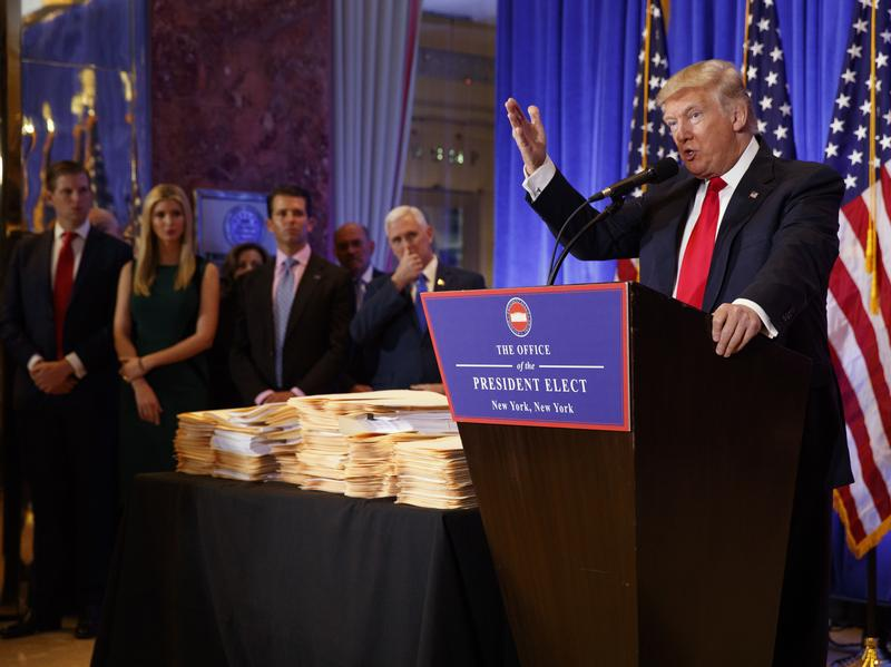 President-elect Donald Trump speaks during a news conference in the lobby of Trump Tower in New York on Wednesday, during which he discussed plans to shift management of his businesses to his sons.