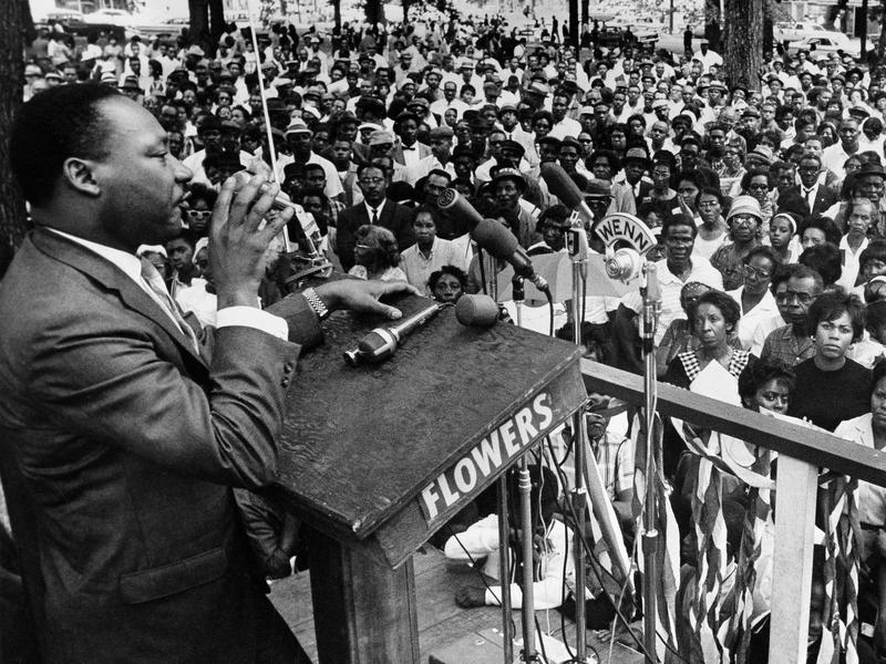 The Rev. Martin Luther King Jr. addresses a crowd in Birmingham, Ala., in 1966. President Obama has designated an historic civil rights district in Birmingham as a national monument.