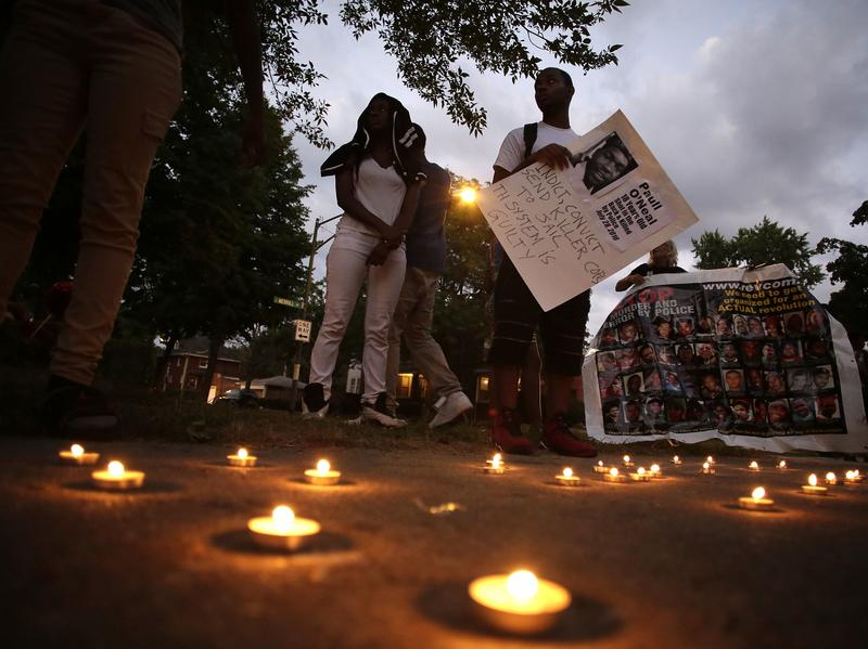 Friends of Paul O'Neal attend a vigil to remember him on Aug. 5, 2016, in Chicago. O'Neal, an unarmed 18-year-old man, was shot and fatally wounded the month before when Chicago police officers tried to arrest him for allegedly stealing a car from the suburbs.