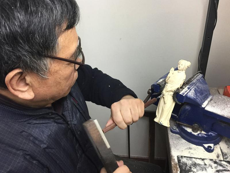 Li Chunke, a carver at the state-owned Beijing Ivory Carving factory, at work in his Beijing workshop.