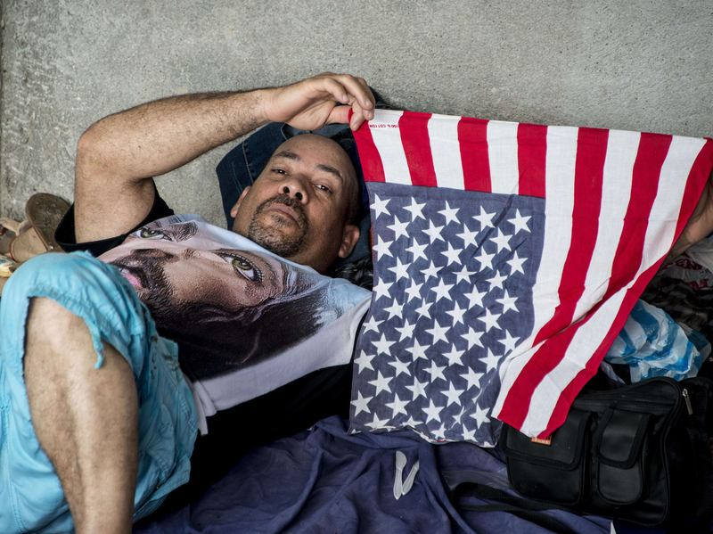 "A Cuban migrant bound for the U.S. by way of Central America rests in a shelter in Costa Rica in November 2015. Until President Barack Obama ended the so-called ""wet foot, dry foot"" policy on Thursday, Cubans who reached U.S. soil either by sea or land were allowed to stay and seek permanent residency."