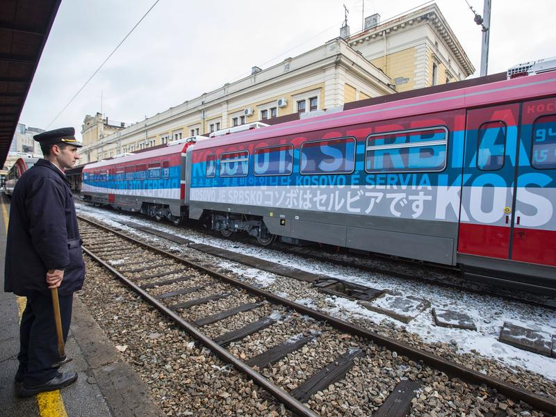"""A train decorated with Serbia's national colors and the phrase """"Kosovo is Serbia"""" was stopped at the border of Kosovo on Saturday. The incident has stoked tensions between the two sides."""