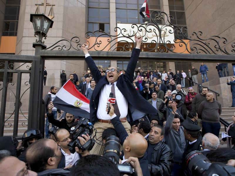 Lawyer and former presidential candidate Khaled Ali (center) celebrates with others after the Supreme Administrative Court said two islands, Sanafir and Tiran, are Egyptian on Monday in Cairo, Egypt.
