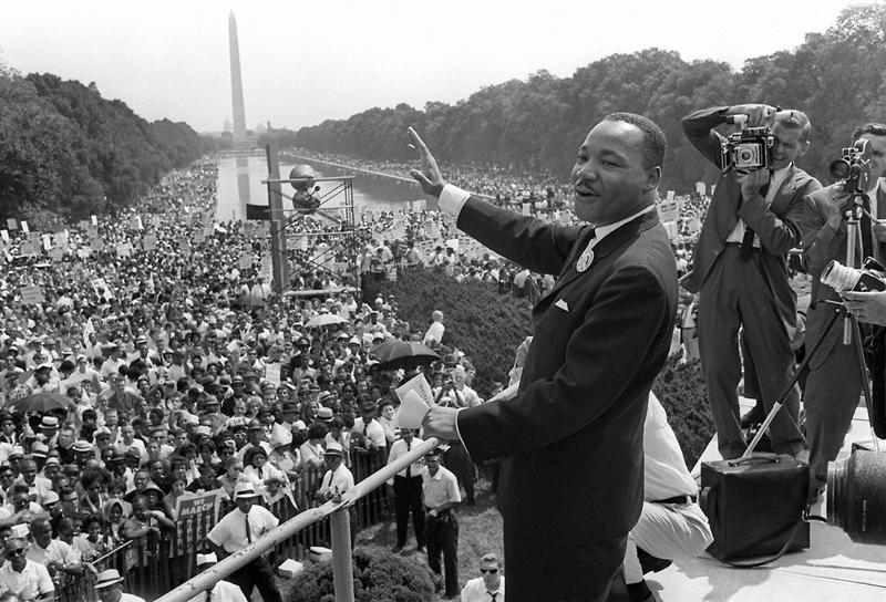 """Martin Luther King Jr. waves to supporters from the steps of the Lincoln Memorial in Washington, D.C., during the March on Washington where King delivered his famous """"I Have a Dream"""" speech on Aug. 28, 1963. (AFP/Getty Images)"""