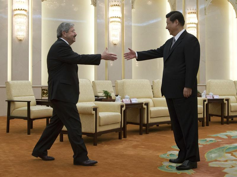 Iowa Gov. Terry Branstad greets Chinese President Xi Jinping before a meeting at the Great Hall of the People in Beijing in April 2013. The two first met in 1985, during a visit by Xi to Iowa.